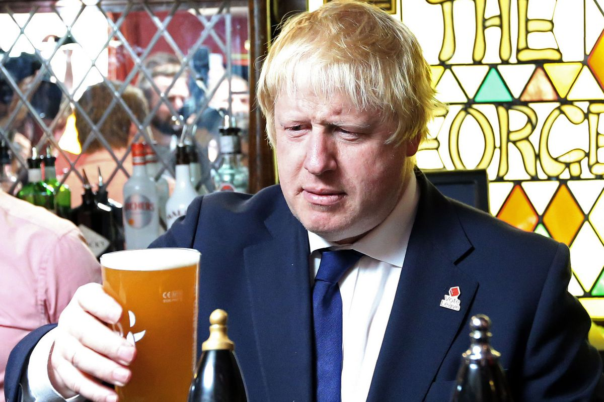 Boris Johnson stares at a pint of beer in a pub