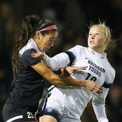 UNLV Michaela Morris (25) and BYU Bizzy Phillips Bowen (10) battle for the ball as BYU and UNLV play in the first round of the NCAA tournament in Provo on Friday, Nov. 11, 2016.