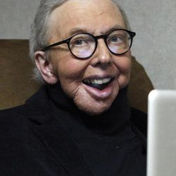 """In this photo taken Wednesday, Jan. 12, 2011, Film critic Roger Ebert works in his office at the WTTW-TV studios in Chicago. Ebert,  will return to his famed show """"Roger Ebert Presents At the Movies."""" featuring co-hosts Christy Lemire of The Associated Press and Ignatiy Vishnevetsky of Mubi.com, appearing in his own segment nearly five years after cancer surgery left him unable to speak."""