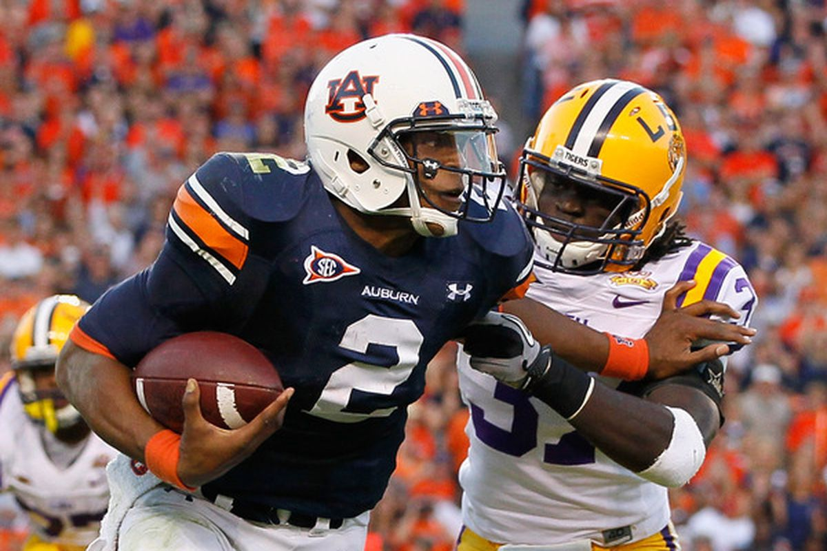 AUBURN AL - OCTOBER 23:  Quarterback Cameron Newton #2 of the Auburn Tigers stiff arms Karnell Hatcher #37 of the LSU Tigers at Jordan-Hare Stadium on October 23 2010 in Auburn Alabama.  (Photo by Kevin C. Cox/Getty Images)