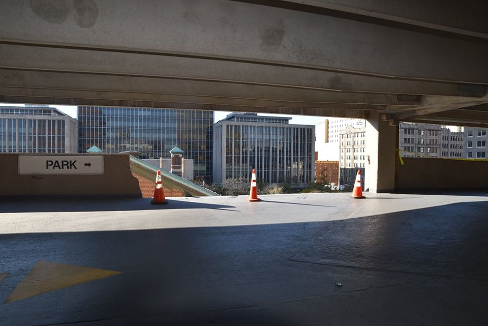 A concrete barrier wall was knocked over from the fourth level of a parking garage in downtown Indianapolis, where two Chicago area residents died.