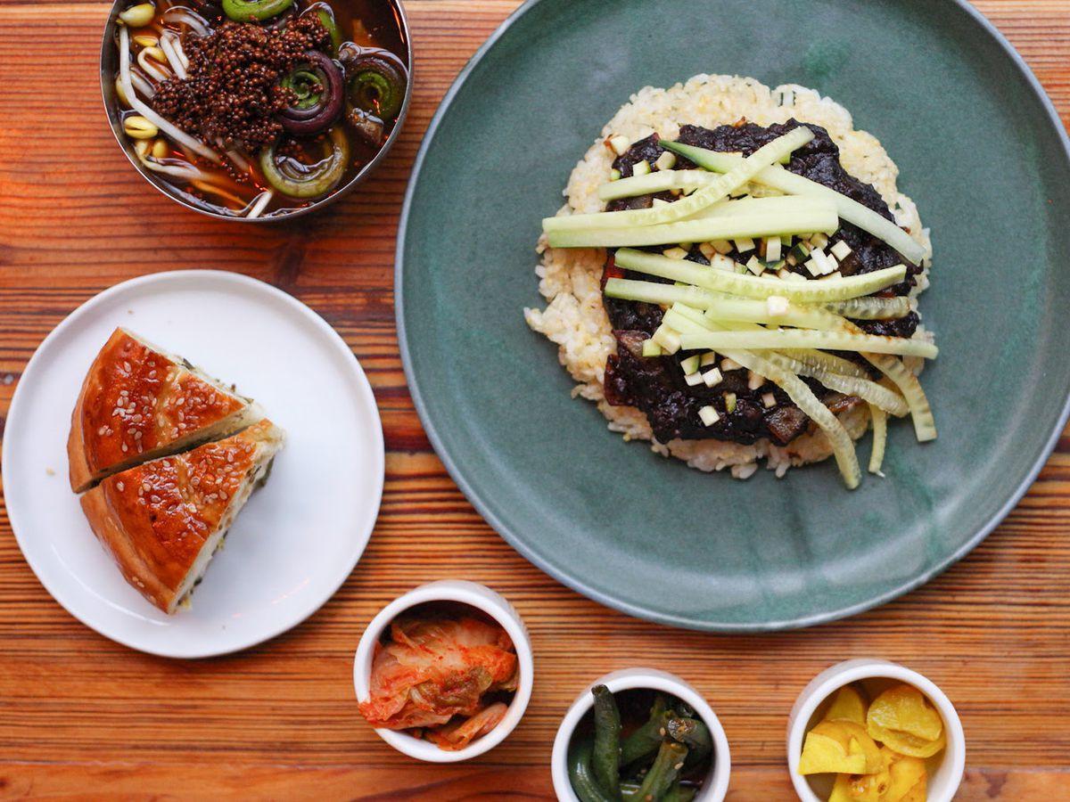 Korean food on plates on a table.