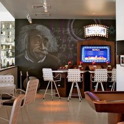 """The """"Einstein Room"""" accommodates 100 people, pool and ping pong tables, vintage board games and more."""