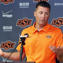 Oklahoma State head coach Mike Gundy answers a question during an NCAA college football news conference in Stillwater, Okla., Monday, Sept. 24, 2012. Gundy believes injured starting quarterback Wes Lunt could return to practice by the end of this week, although he's still uncertain whether he'll be able to play in Saturday night's game against Texas.