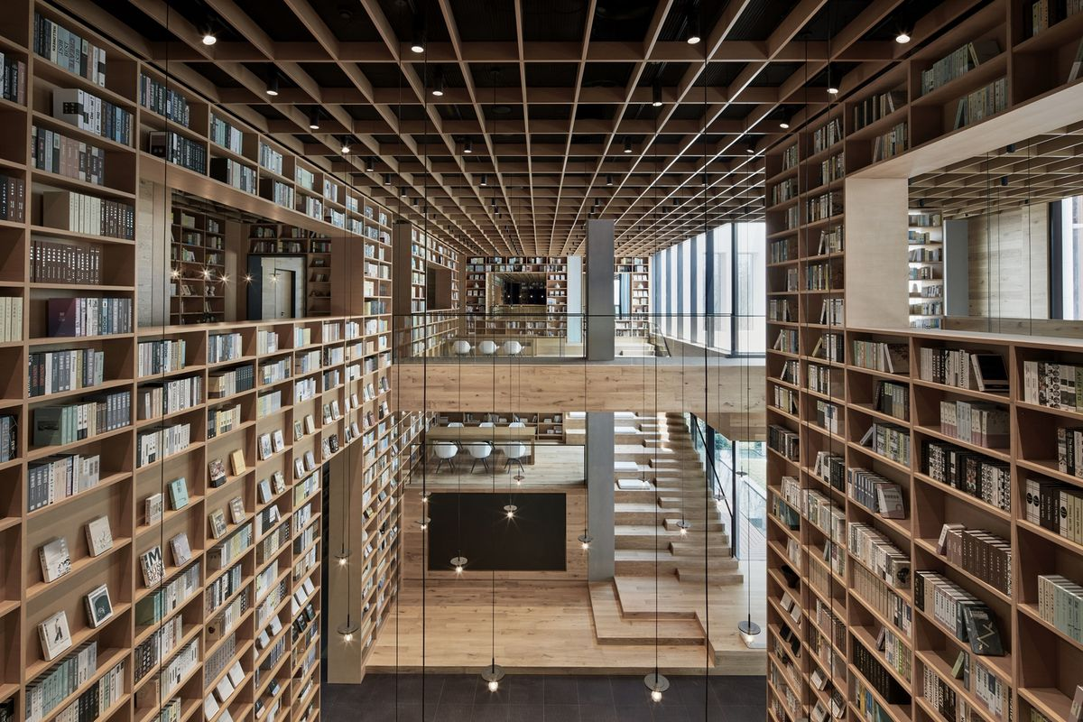 Full height timber shelves filled with books.