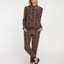 """<a href=""""http://needsupply.com/womens/sale/the-sidney-blouse.html#"""">The Sidney blouse by Babe</a>, $125.99 (was $315)"""