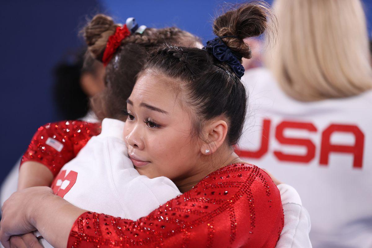 Gymnast Sunisa Lee hugging a teammate.