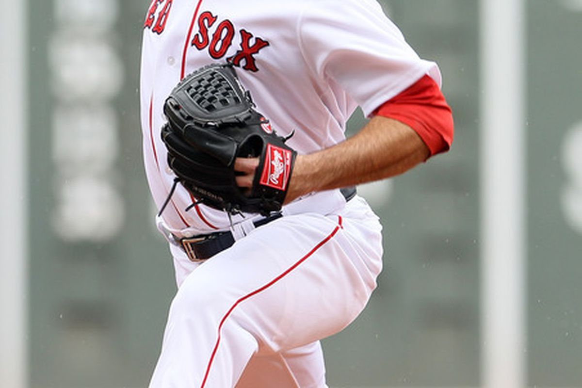 BOSTON, MA - MAY 15:  Josh Beckett #19 of the Boston Red Sox delivers a pitch in the first inning against the Seattle Mariners on May 15, 2012 at Fenway Park in Boston, Massachusetts.  (Photo by Elsa/Getty Images)