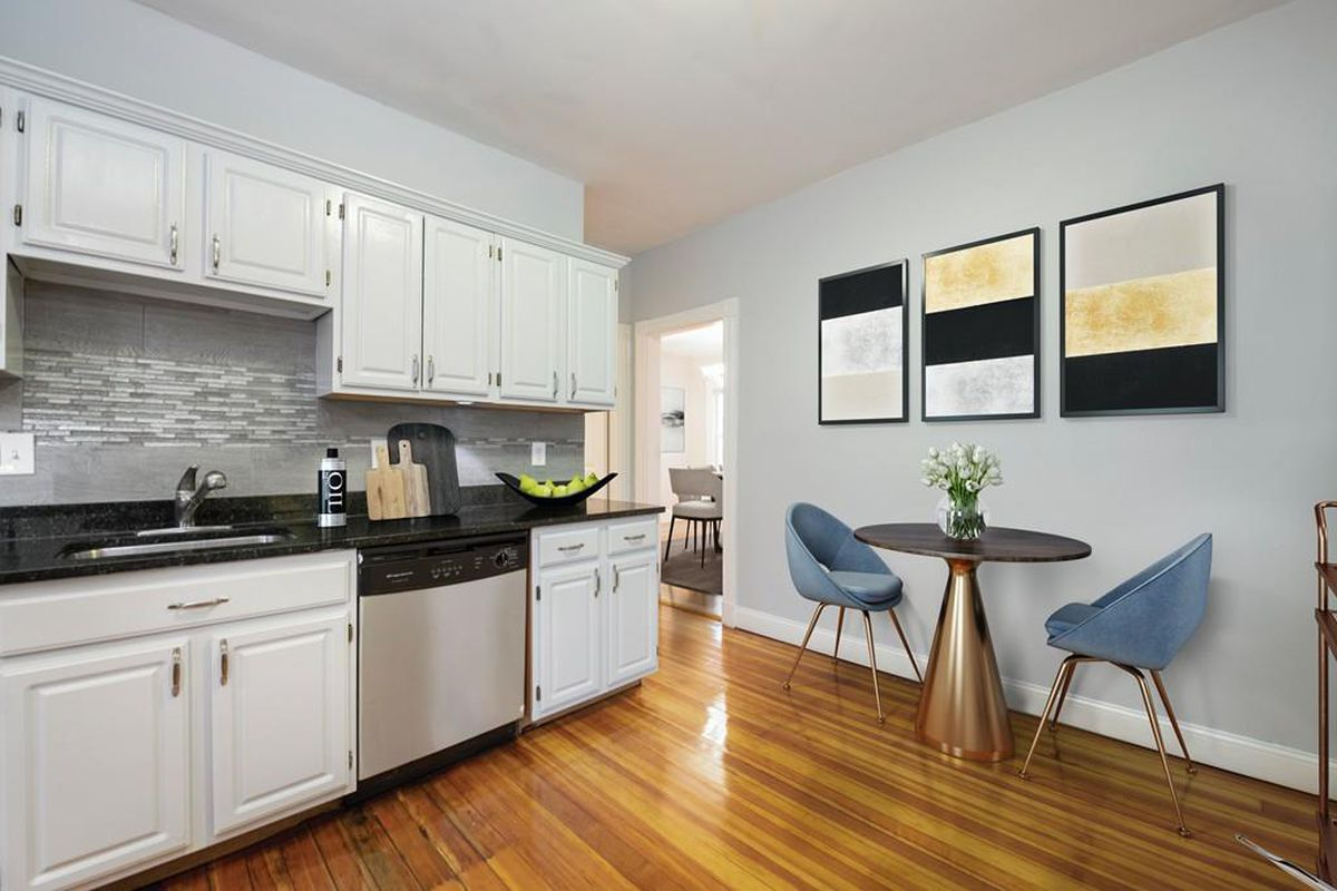A kitchen with a counter and cabinetry and a table.