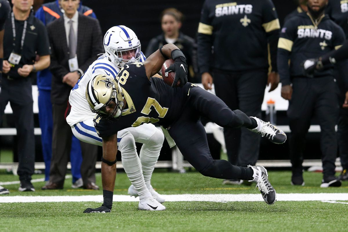 New Orleans Saints tight end Jared Cook is defended by Indianapolis Colts cornerback Quincy Wilson in the second quarter at the Mercedes-Benz Superdome