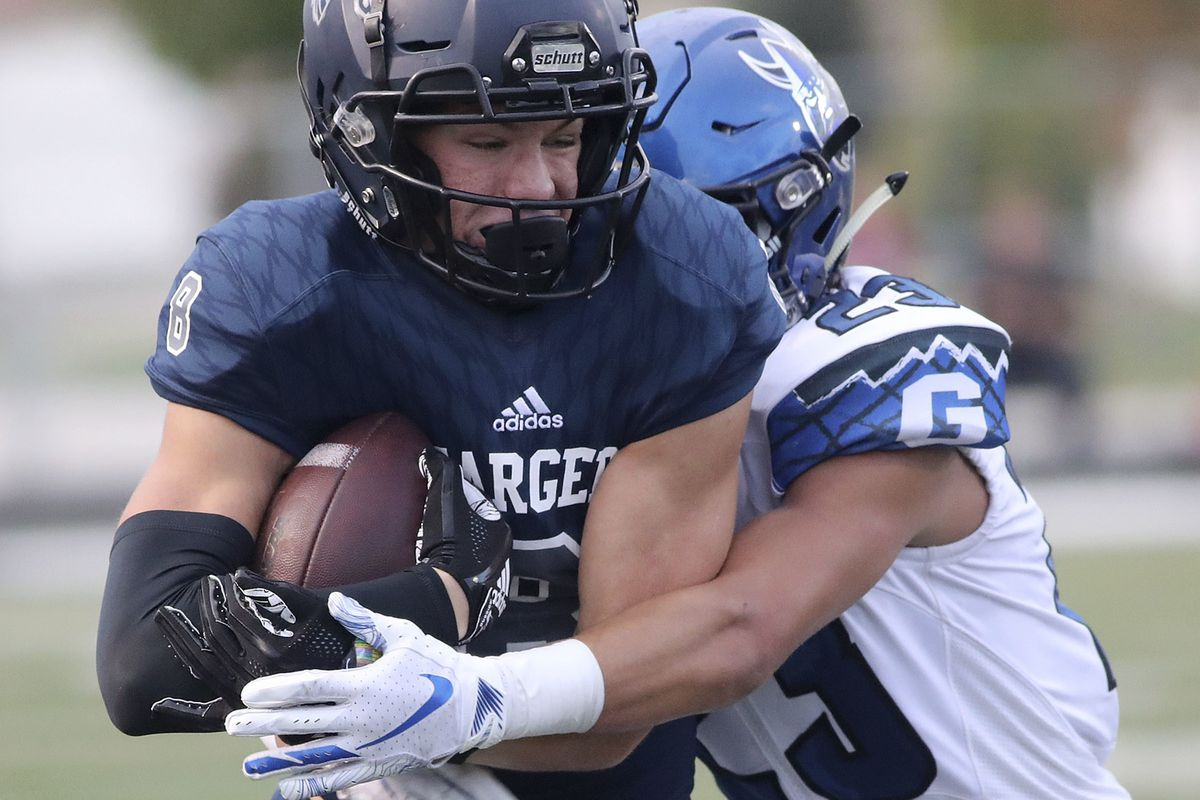Corner Canyon's Noah Kjar gets tackled by Pleasant Grove's Truxton McSpadden during a football game at Corner Canyon High School in Draper on Friday, Aug. 17, 2018.