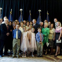 Gary Herbert, center, poses with his family Tuesday after becoming the new governor of Utah.
