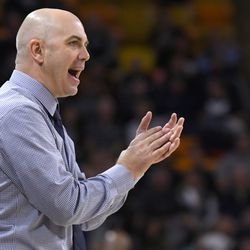 Utah State coach Craig Smith claps during game against North Carolina A&T on Friday, Nov. 15, 2019, in Logan, Utah. Smith was named head coach of the Runnin' Utes on March 27, 2021, replacing Larry Krystkowiak.