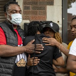 Family and friends comfort Tanya Eison the Dance Captain at Ultimate Threat Dance Organization during a press conference at the studio, Thursday, May 20, 2021. Verndell Smith, the founder of the dance studio was shot and killed yesterday.