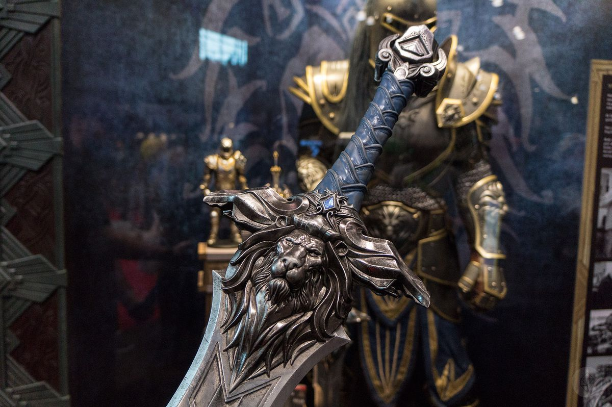 a close-up of the hilt of an Alliance sword with a lion forged into the crossguard at the Weta Workshop booth at NYCC 2015