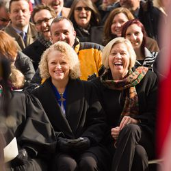 Jackie Biskupski, left, sits with fiancÉe Betty Iverson prior to being sworn in as Salt Lake City's first openly gay mayor during a  ceremony outside the City-County Building on Monday, Jan. 4, 2016.