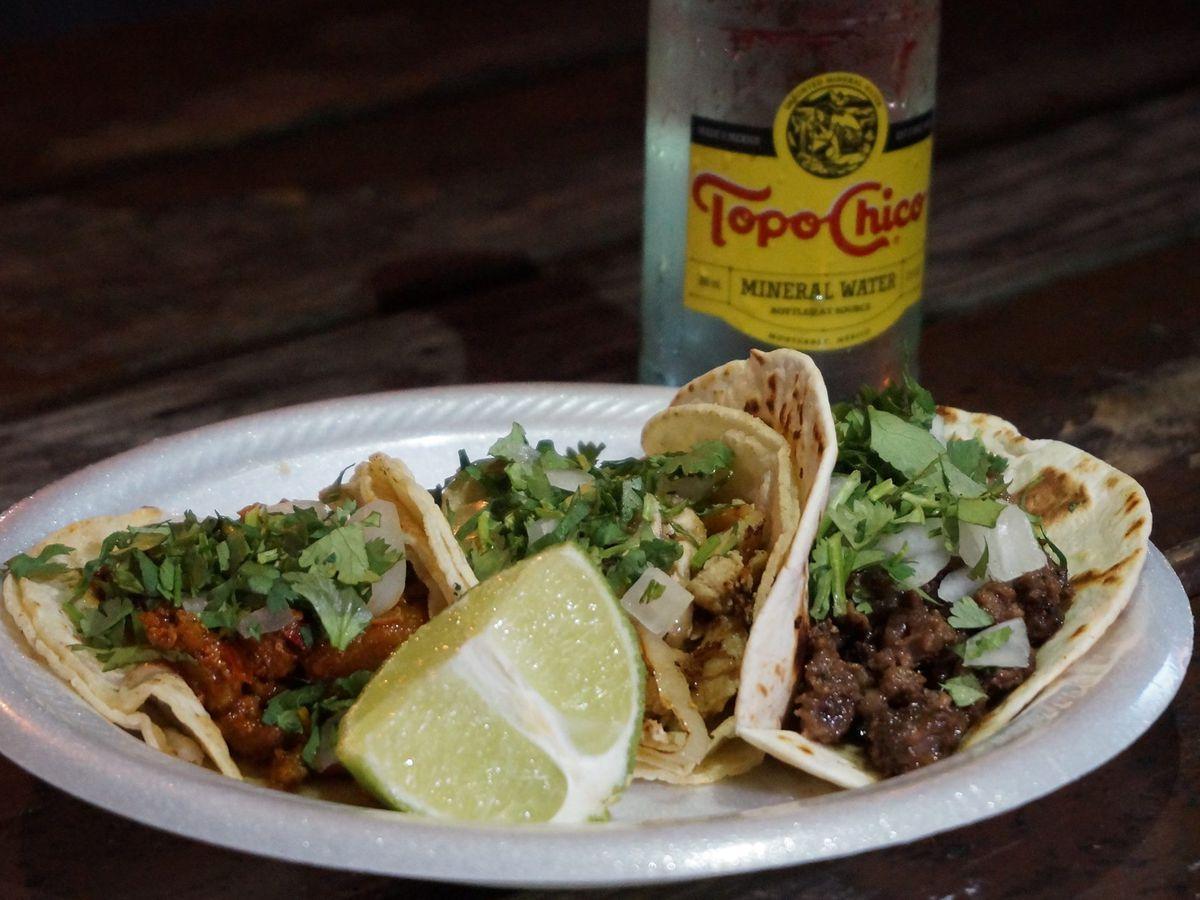 Al pastor, pollo, and carne asada tacos from El Super Taco