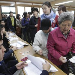 South Koreans line up to cast their ballots for the parliamentary election at a polling station in Seoul, South Korea, Wednesday, April 11, 2012.