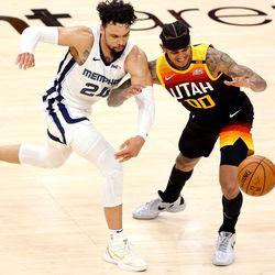 Memphis Grizzlies forward Dillon Brooks (24) knocks the ball away from Utah Jazz guard Jordan Clarkson (00) as the Utah Jazz and the Memphis Grizzlies play in game 5 at Vivint Arena in Salt Lake City on Wednesday, June 2, 2021. Utah won 126-110, Utah advances to the second round.