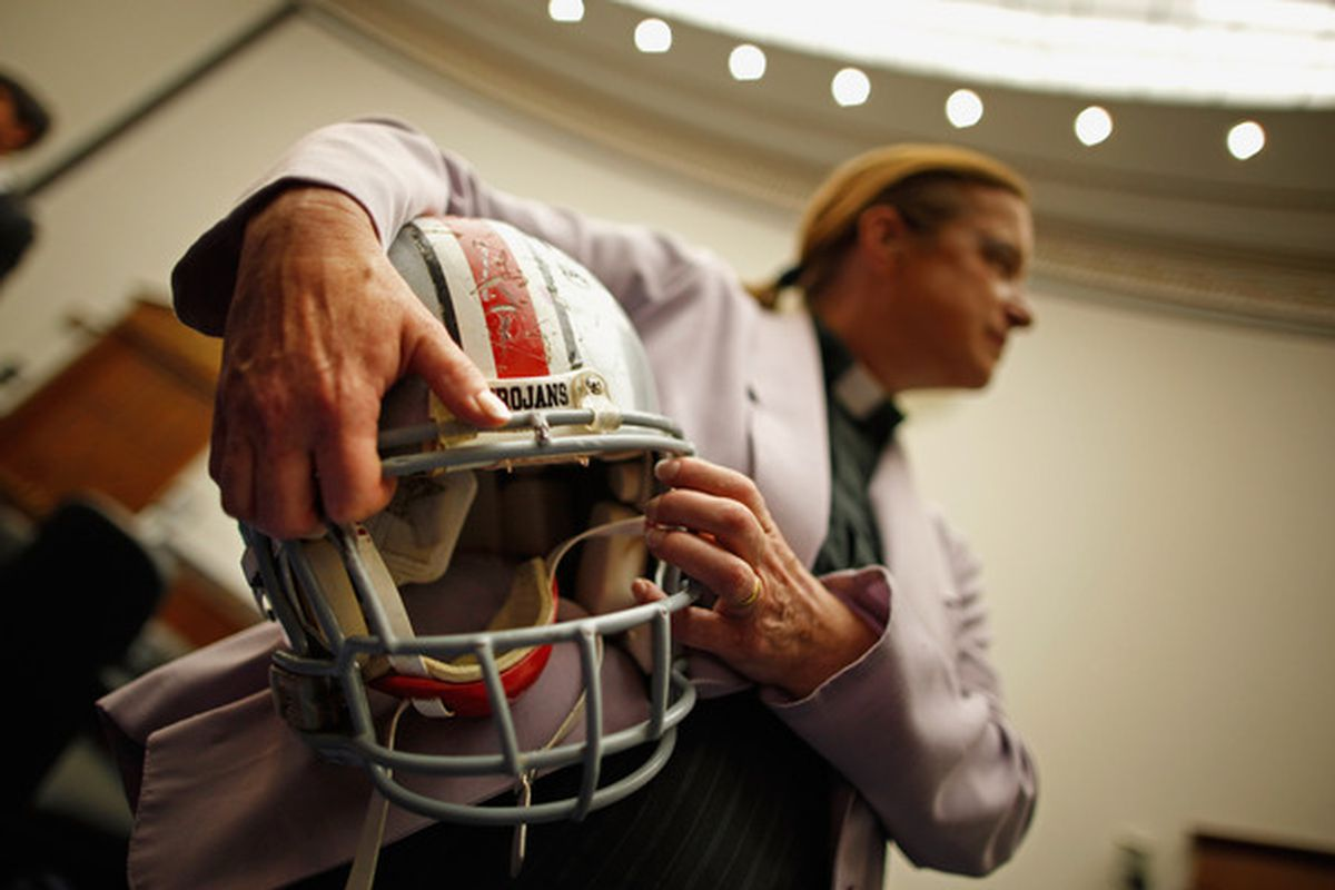 Katherine Brearley, mother of the late Owen Thomas, a former University of Pennsylvania football player, holds her son's high school football helmet after testifying before the House Education and Labor Committee
