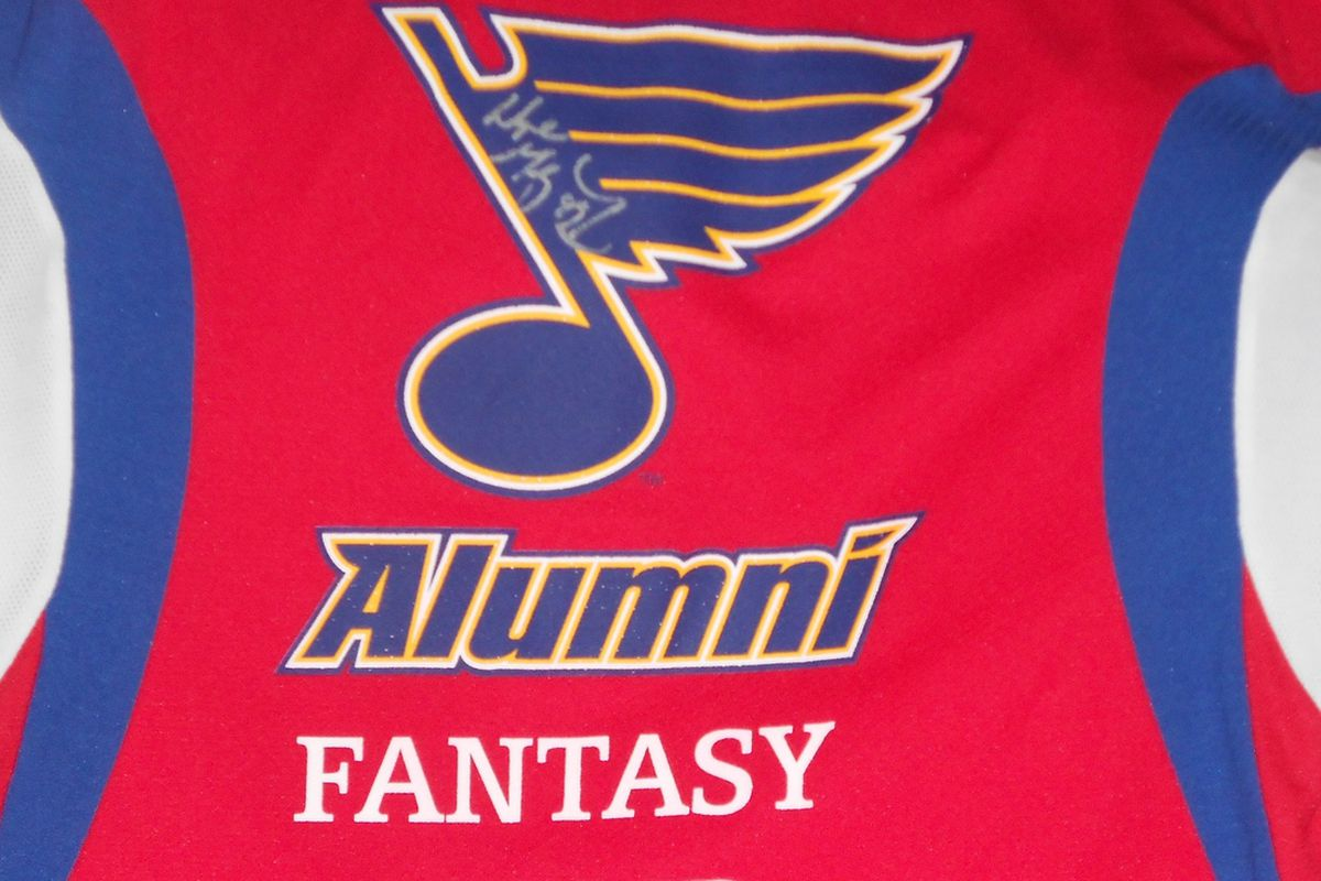 Jersey from Blues fantasy camp signed by Wayne Gretzky