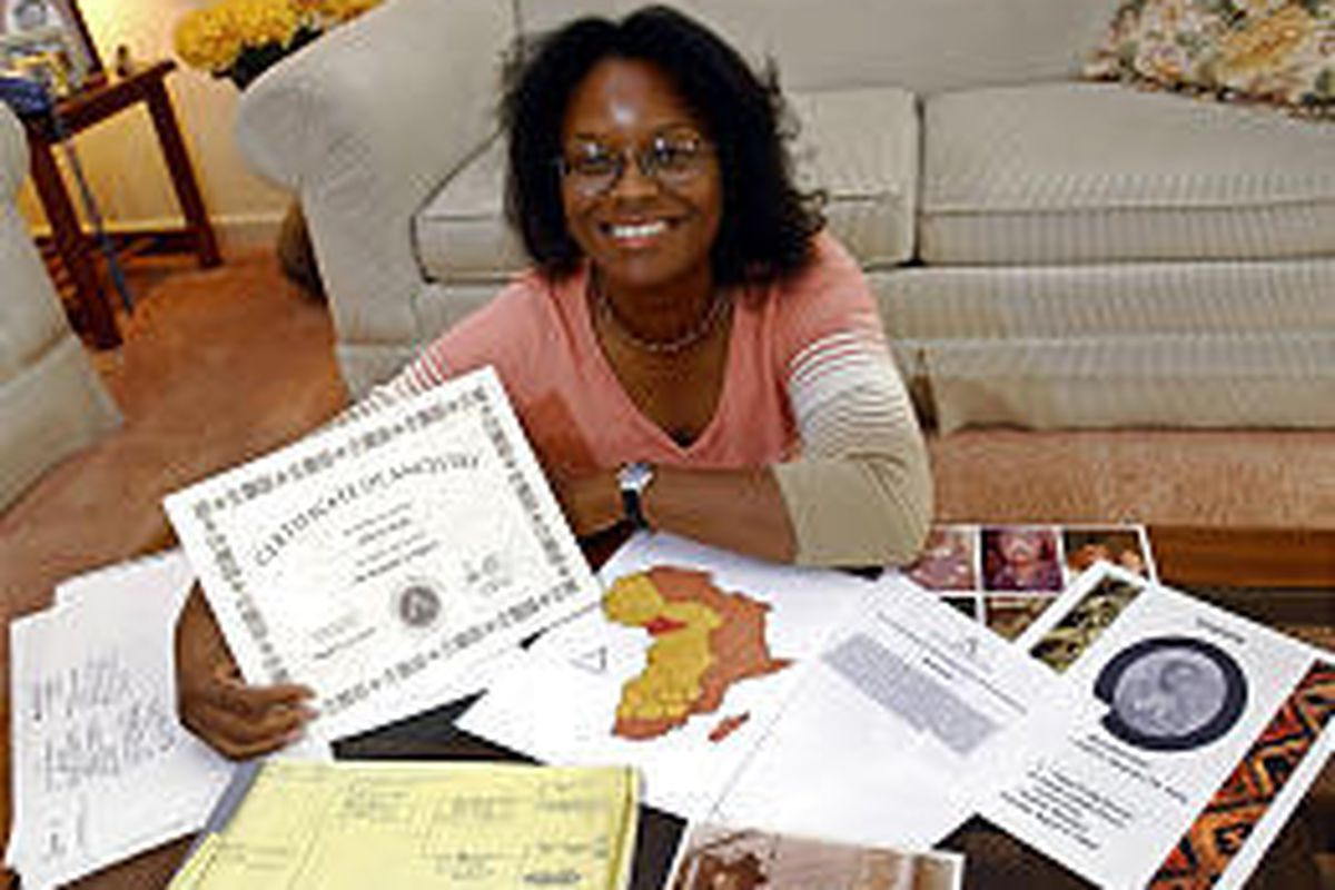 Monica Myles holds a certificate from African Ancestry Inc. showing which tribe her ancestors came from.