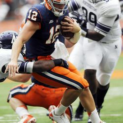 Syracuse quarterback Ryan Nassib (12) runs for a first down against Northwestern during the first quarter of an NCAA college football game in Syracuse, N.Y., Saturday, Sept. 1, 2012.