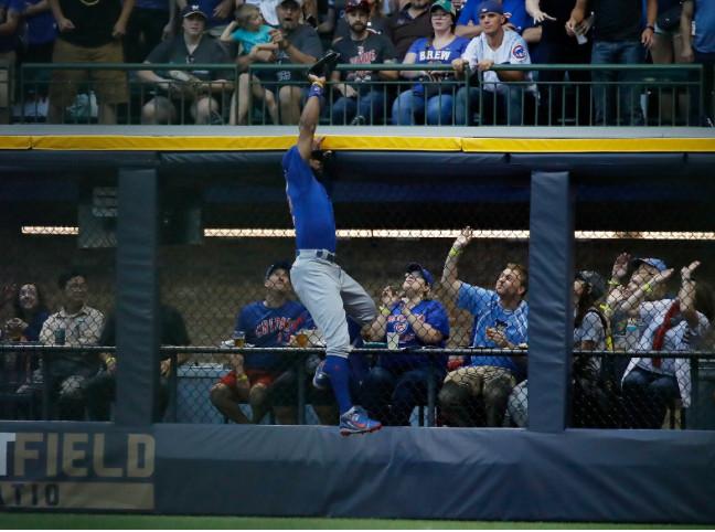 <em>Cubs right fielder Jason Heyward robs Ryan Braun of a would-be homer in the third.</em>