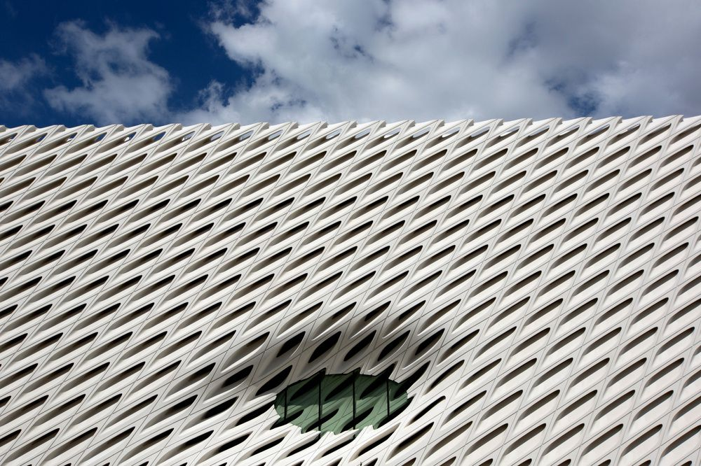 The exterior of the Broad Museum. The facade is white with a serrated design.