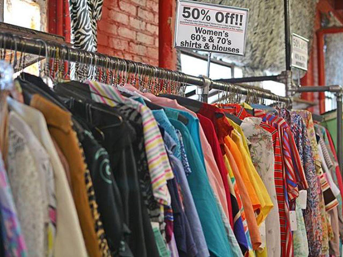 "Vintage racks at Garment District, via <a href=""https://www.facebook.com/TheGarmetDistrict/photos/a.110926535613526.6861.106510229388490/731463960226444/?type=1&amp;relevant_count=1"">Facebook</a>"