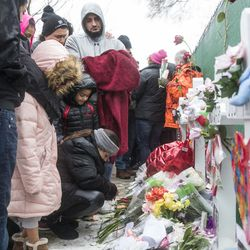 Hundreds of mourners pay their respects at a prayer vigil for the five people killed two days earlier in a mass shooting at the Henry Pratt Company in Aurora, Sunday afternoon, Feb. 17, 2019.   Ashlee Rezin/Sun-Times