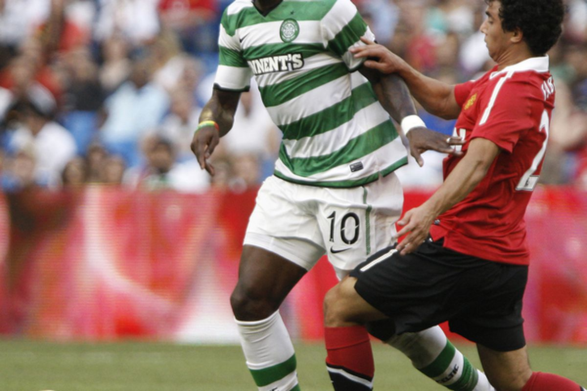 TORONTO - JULY 16: Fabio #20 of Manchester United battles for the ball with Marc Fortune #10 of Celtic F.C. during a friendly match at the Rogers Centre July 16 2010 in Toronto Ontario Canada. (Photo by Abelimages/Getty Images)