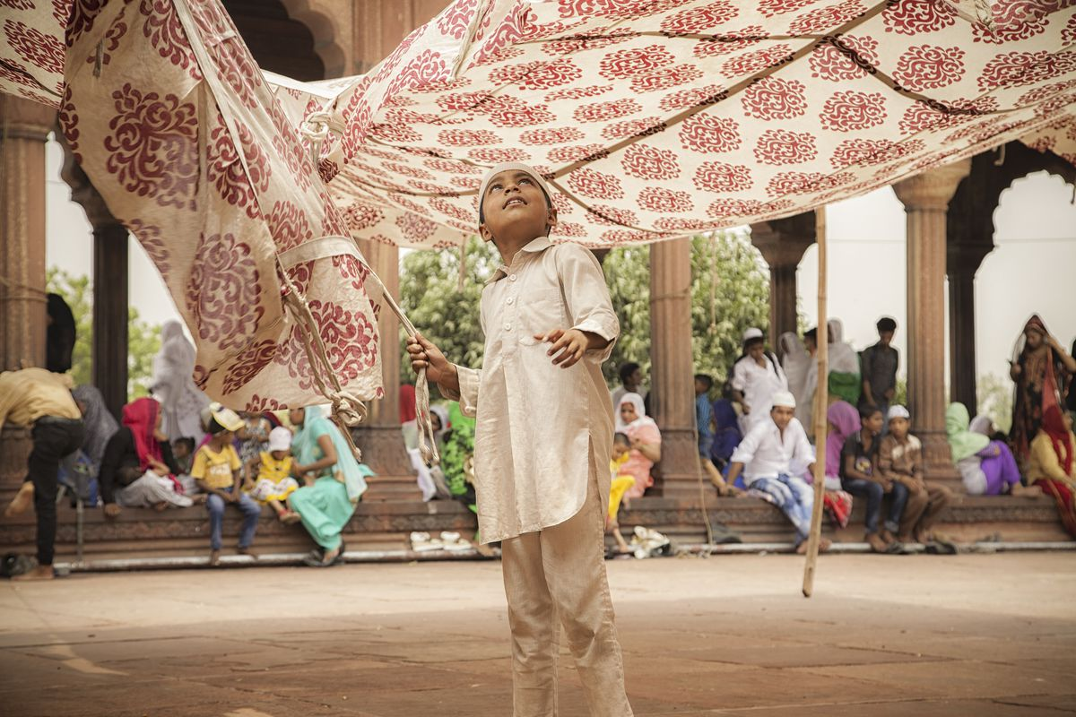 June 8: A young boy plays during the last Friday of the holy month of Ramadan at the Jama Masjid in the old quarters of New Delhi, India. (Noemi Cassanelli/AFP/Getty Images)