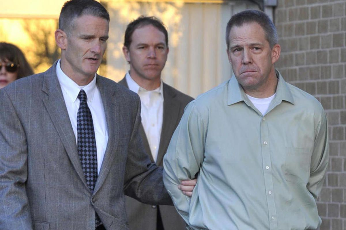 FILE - In this April 2, 2012, file photo JetBlue pilot Clayton Frederick Osbon, right, is escorted to a waiting vehicle by FBI agents as he is released from The Pavilion at Northwest Texas Hospital, in Amarillo, Texas. Osbon, who disrupted a Las Vegas-bou