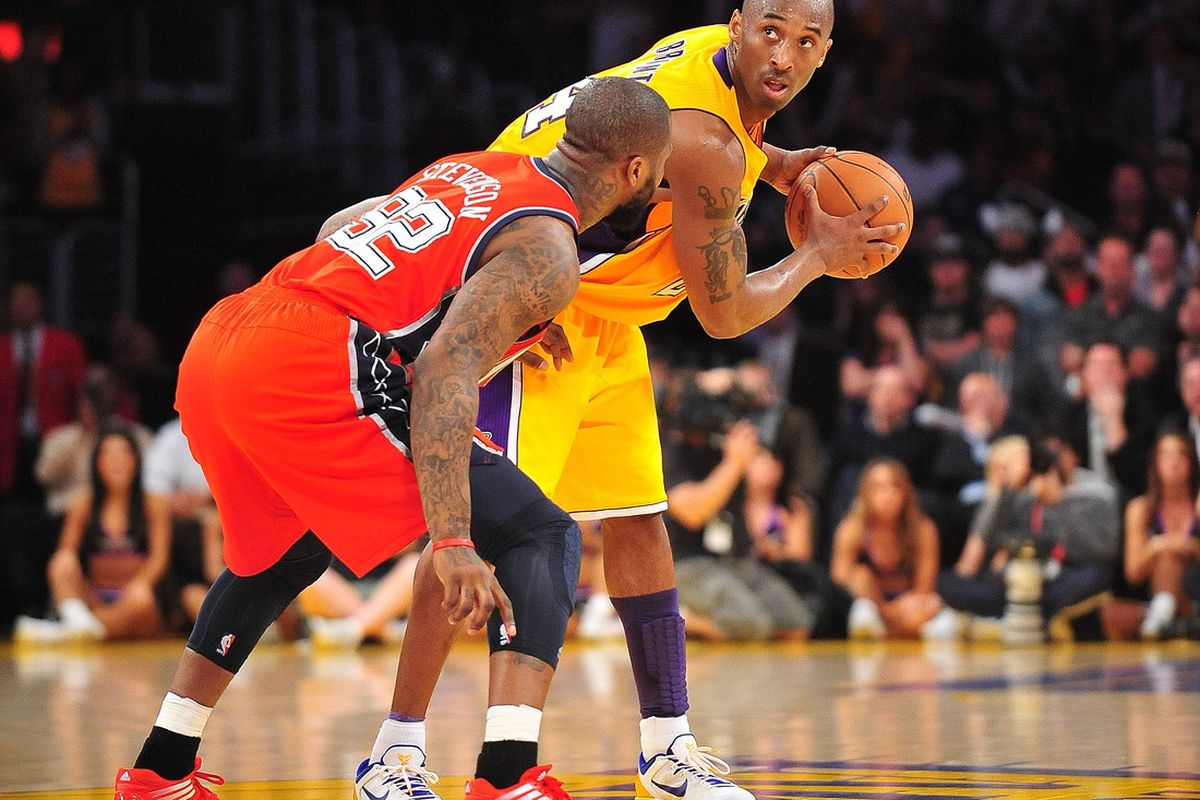 April 3, 2012; Los Angeles, CA, USA; Los Angeles Lakers shooting guard Kobe Bryant (24) controls the ball against the New Jersey Nets during the second half at Staples Center. Mandatory Credit: Gary A. Vasquez-US PRESSWIRE