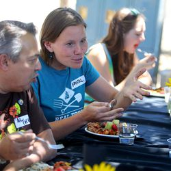 Krystal Rogers-Nelson, Real Food Rising program coordinator, eats lunch at the Real Food Rising farm in Salt Lake City on Wednesday, July 13, 2016.