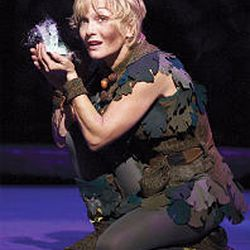 Cathy Rigby, in her role as Peter Pan, holds tiny Tinkerbell