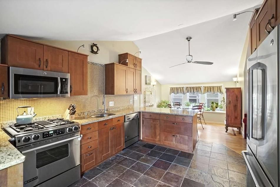 A kitchen leading to a dining room.
