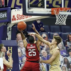 Utah guard Alfonso Plummer (25) puts up a shot as Washington guard Cole Bajema, right, defends, during the first half of an NCAA college basketball game, Sunday, Jan. 24, 2021, in Seattle.