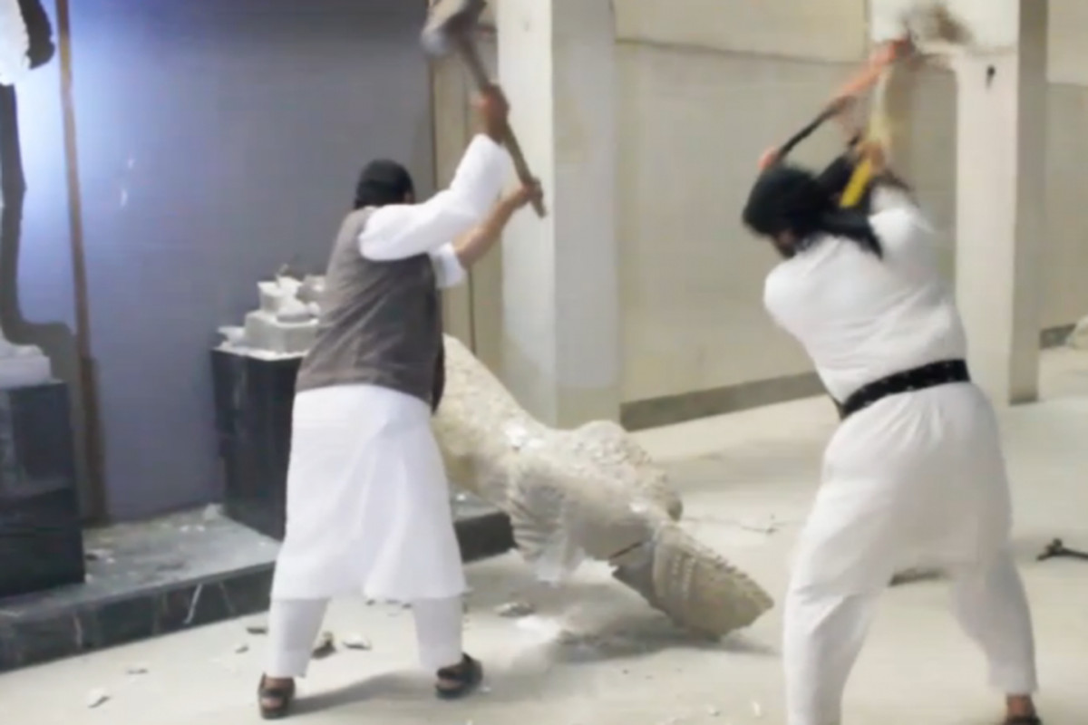 ISIS militants destroy ancient artifacts in Mosul, as captured in ISIS video
