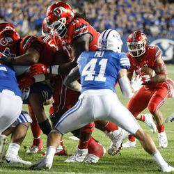 BYU and Utah compete during the first half of an NCAA college football gameat LaVell Edwards Stadium in Provo on Saturday, Sept. 11, 2021.