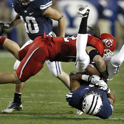 Utah linebacker Chaz Walker slams BYU wide receiver Ross Apo to the ground during Utah's blowout victory over the Cougars at LaVell Edwards Stadium in Provo.