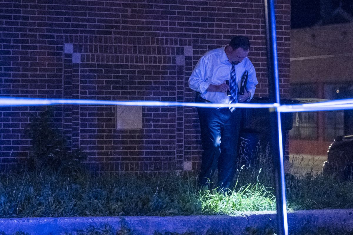 Police investigate a person shot Sunday night in the 1000 block of North Drake in Chicago. | Tyler LaRiviere/Sun-Times