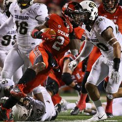 Utah Utes running back Zack Moss (2) runs the ball during the game against the Colorado Buffaloes at Rice-Eccles Stadium in Salt Lake City on Saturday, Nov. 25, 2017.