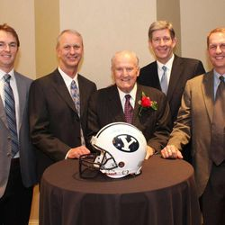 """Retired BYU coach LaVell Edwards, center, poses with four former quarterbacks, from left, John Beck, Robbie Bosco, Elder Gifford Nielsen and Ty Detmer. Coach Edwards was this recipient this day of the 2013 Paul """"Bear"""" Bryant Lifetime Achievement Award. Photo by Kelly Foss."""