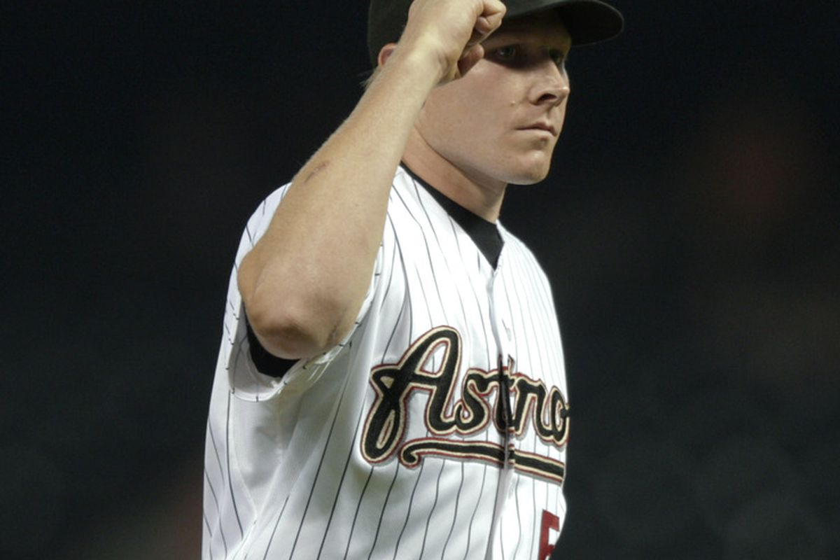 HOUSTON - APRIL 14:  Pitcher Mark Melancon #54 of the Houston Astros pumps his fist after getting out of jam in the eightg inning against the San Diego Padres at Minute Maid Park on April 14, 2011 in Houston, Texas.  (Photo by Bob Levey/Getty Images)