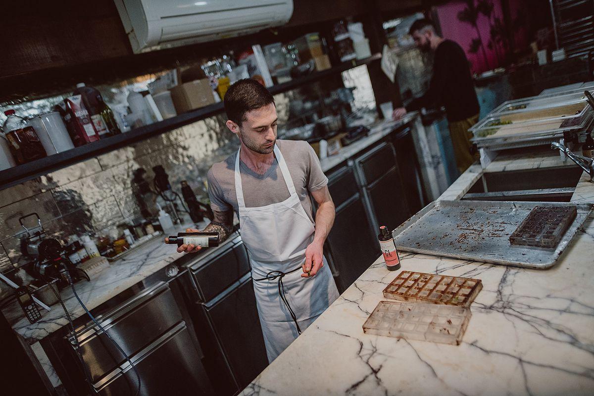 Simon Brown works on chocolates in the Topogato chocolate lab