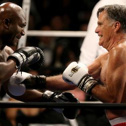 Five-time heavyweight champion Evander Holyfield fights former Massachusetts Gov. Mitt Romney at Charity Vision Fight Night at The Rail Event Center in Salt Lake City on Friday, May 15, 2015.