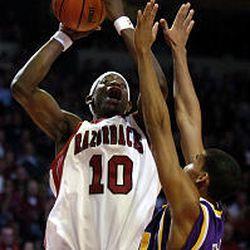 Utah Jazz draft pick Ronnie Brewer, from Arkansas, shoots over LSU's Garrett Temple. Brewer was chosen No. 14 in the NBA Draft.