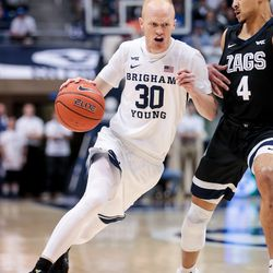 Brigham Young Cougars guard TJ Haws (30) drives against Gonzaga Bulldogs guard Ryan Woolridge (4) at the Marriott Center in Provo on Saturday, Feb. 22, 2020.